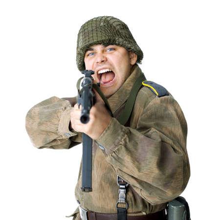 machine man: Soldier shoots submachine gun isolated on white background
