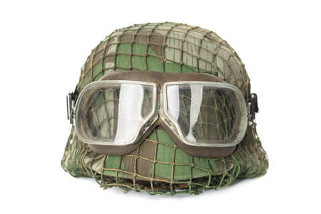 camouflaged helmet with protective goggles isolated on white background photo