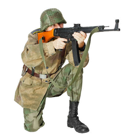 Soldier with submachine gun, second world war style  Isolated on white background