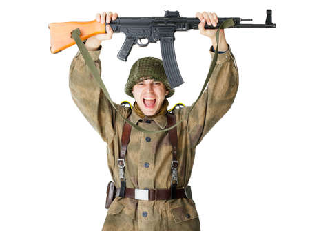 holding gun to head: Soldier holding machine gun over head isolated on white background