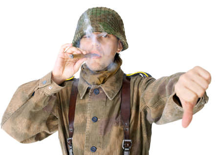 nazism: Soldier smoking a cigar and gives a thumb down isolated on white background Stock Photo