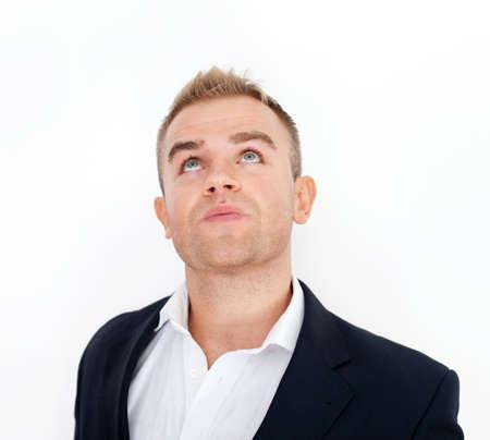 Thoughtful business man looking upward Stock Photo - 18355316