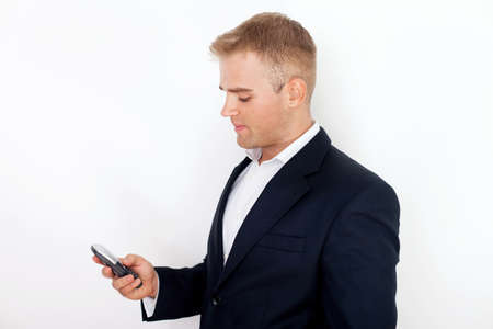 happy successful young business man talking on cell phone on white background Stock Photo - 18355351