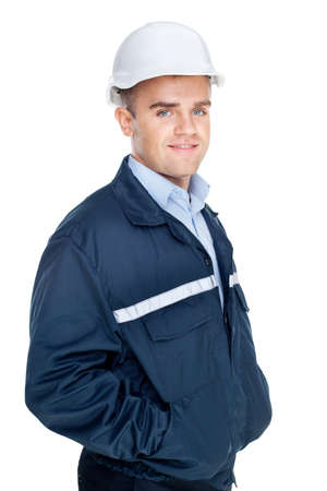 Engineer with white hard hat standing confidently isolated on white background  Stock Photo