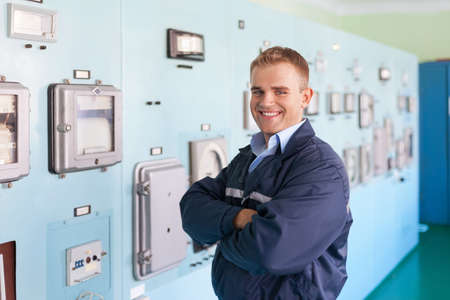Portrait of young engineer at control room photo