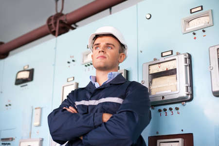 control room: Portrait of young engineer at control room Stock Photo