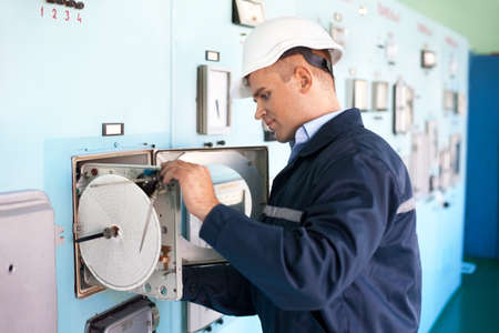 engine room: Young engineer working at control room Stock Photo