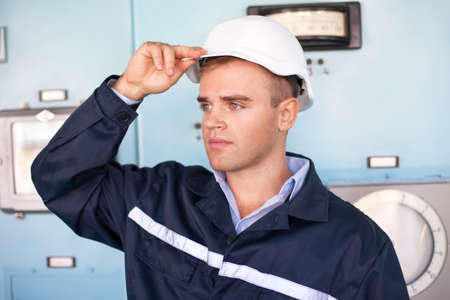 Portrait of young engineer in control room photo