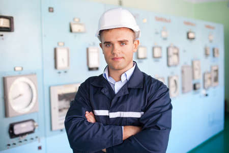 control panel: Portrait of young engineer at control room Stock Photo