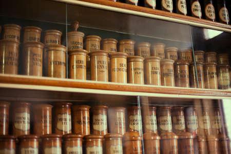 medicine cabinet: Bottles on the shelf in old pharmacy