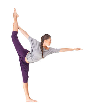 Young woman doing yoga exercise Natarajasana (Lord of the Dance Pose). Isolated on white background Stock Photo