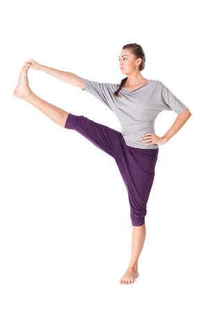 utthita: Young woman doing yoga exercise Utthita Hasta Padangustasana. Isolated on white background