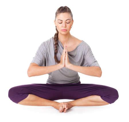 baddha: Young woman doing yoga asana Baddha Konasana (Bound Angle Pose). Isolated on white background Stock Photo