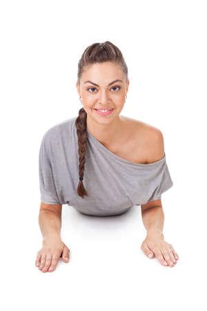 bhujangasana: Young woman doing yoga exercise  Bhujangasana (cobra pose). Isolated on white background