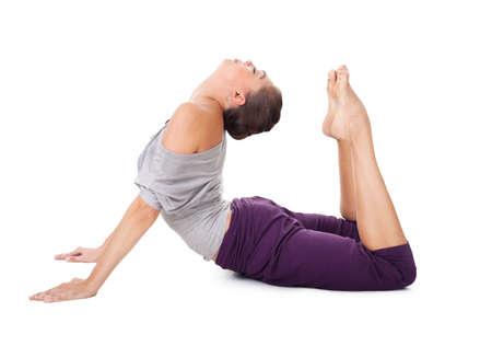 bhujangasana: Young woman doing yoga exercise Bhujangasana (cobra pose). Isolated on white background Stock Photo