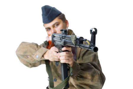 Soldier shoots submachine gun isolated on white background photo