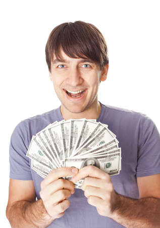 Portrait of a young smiling man holding a dollar bills isolated on white background Stock Photo - 18354100