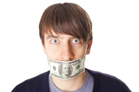 mouth closed: Portrait of young man with a 100 dollar banknote on his mouth isolated on white background