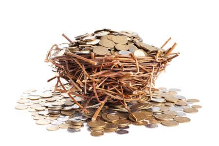 kopek: Nest full of coins isolated on white background Stock Photo