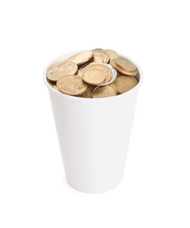 Coins in a white cup isolated on white background photo