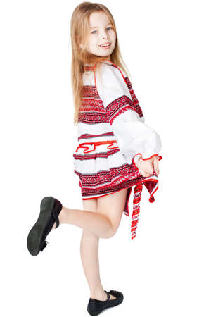 Portrait of joyful young Ukrainian girl in national costume  Isolated on white background
