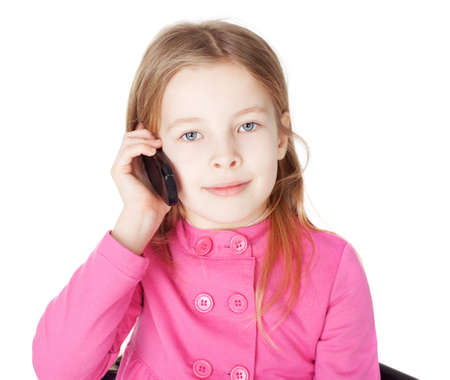Portrait of surprised little girl with cell phone isolated on white background photo