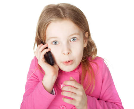 Portrait of surprised little girl with cell phone isolated on white background Stock Photo - 18353987