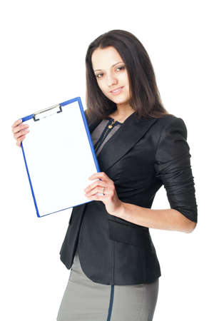 Portrait of beautiful young smiling businesswoman showing blank clipboard isolated on white background photo