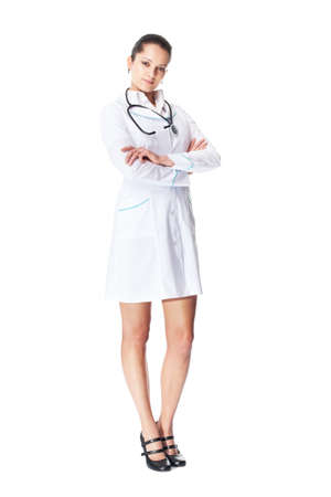 Full length portrait of young smiling female doctor with arms crossed isolated on white background photo