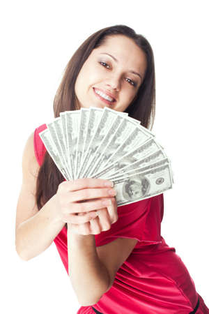 Portrait of pretty young smiling woman holding a dollar bills isolated on white background photo