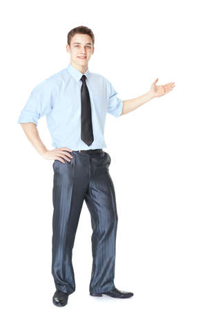 Full length portrait of young successful businessman showing a copy space isolated on white background photo
