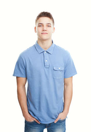 Portrait of smiling young man standing with hands in pockets isolated on white background Stock Photo - 22003281