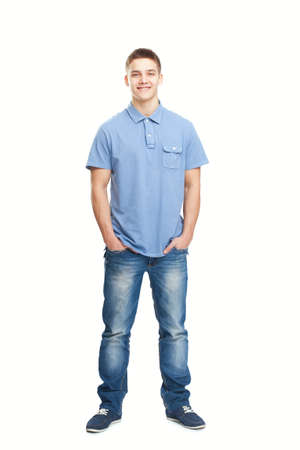 Full length portrait of smiling young man standing with hands in pockets isolated on white background Stock Photo - 22003282
