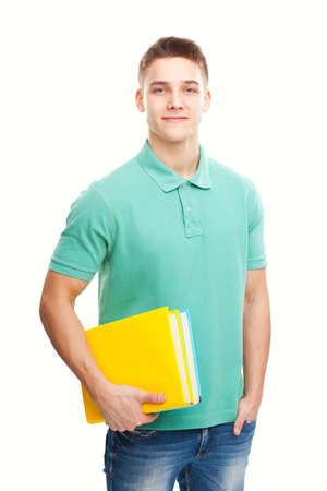 one young man: portrait of happy smiling student with his notebook isolated on white background