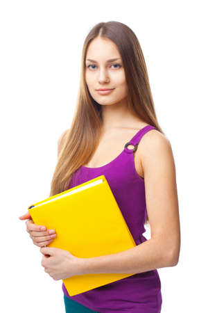 Portrait of a pretty young student girl holding yellow book isolated on white background