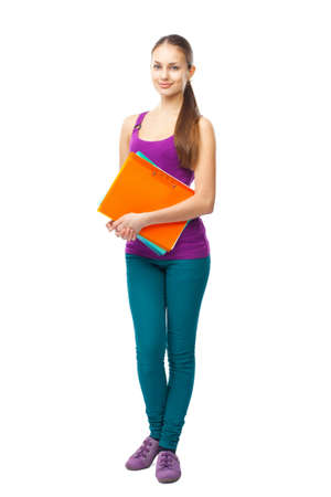 Full length portrait of a pretty young happy smiling student girl with folders isolated on white background photo