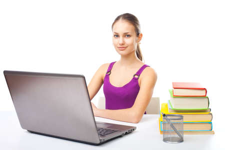 Portrait of pretty young smiling student girl working on a laptop isolated on white background Stock Photo - 22003537