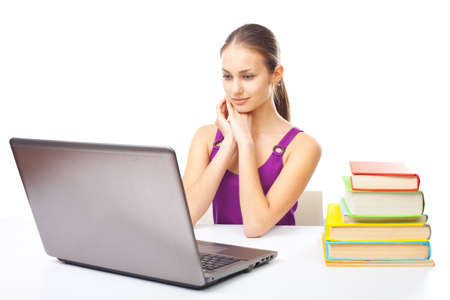 Portrait of pretty young smiling student girl working on a laptop isolated on white background Stock Photo - 22003539