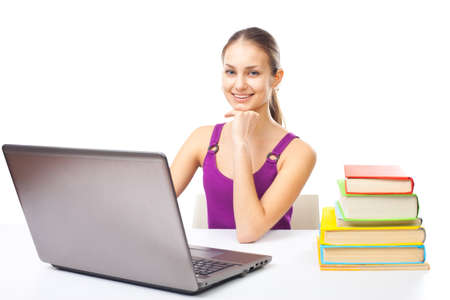 Portrait of pretty young happy smiling student girl working on a laptop isolated on white background Stock Photo - 22003540