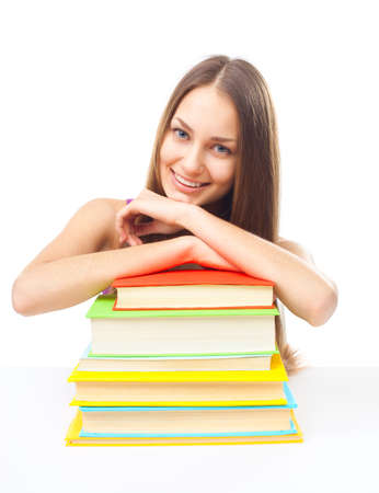 Portrait of pretty young happy smiling student girl with pile of books isolated on white background photo