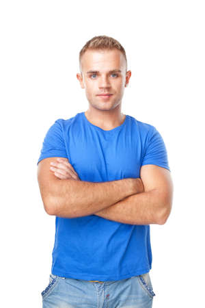 Portrait of young man standing with hands folded against isolated on white background Stock Photo - 22003596