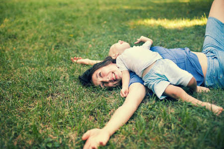 Mother and son having fun on the grass with copy-space Stock Photo - 22003609