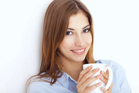 Portrait of a young woman with cup of tea or coffee  Stock Photo - 22003676