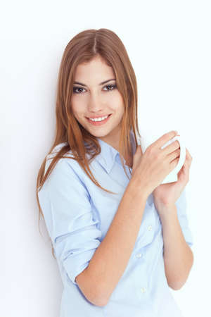 Portrait of a young woman with cup of tea or coffee  Stock Photo - 22003683