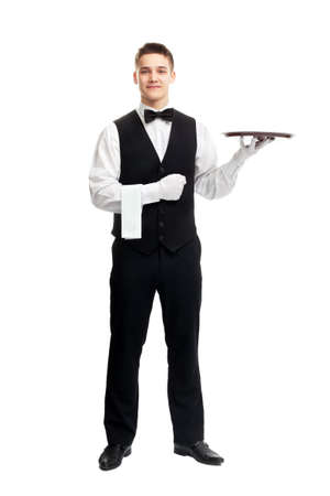 butler: full length portrait of young happy smiling waiter with empty tray isolated on white background