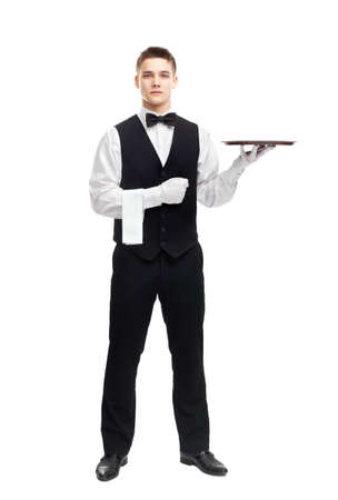 full length portrait of young happy smiling waiter with empty tray isolated on white background photo