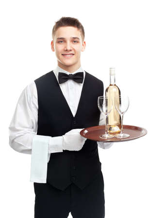 waiter tray: Portrait of young happy smiling waiter with bottle of white wine and stemware glass on tray isolated on white background Stock Photo