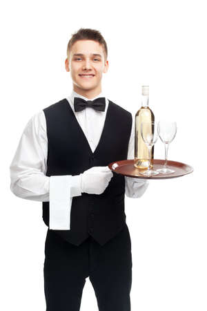 young happy smiling waiter with bottle of white wine and stemware glass on tray isolated on white background photo