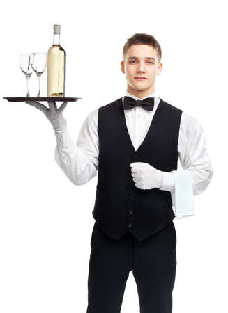 Portrait of young happy smiling waiter with bottle of white wine and stemware glass on tray isolated on white background photo