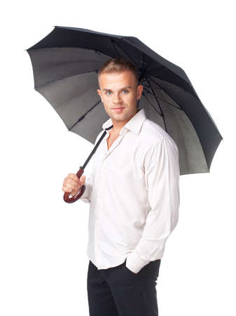 Portrait of young man under an umbrella isolated on white background photo